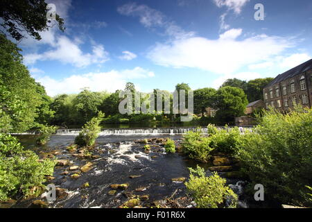 Bamford Mill and weir on the River Derwent in the Peak District National Park, England, UK - Stock Photo