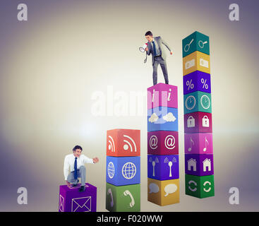 Composite image of businessman shouting through megaphone - Stock Photo
