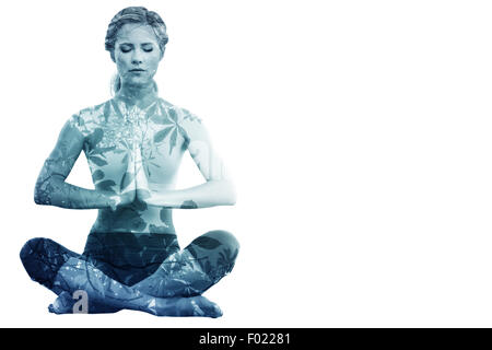 Composite image of calm blonde sitting in lotus pose with hands together - Stock Photo