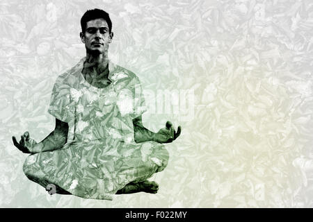 Composite image of handsome man in white meditating in lotus pose - Stock Photo