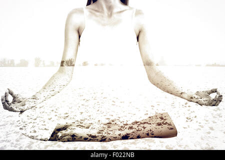 Composite image of toned woman in lotus pose at fitness studio - Stock Photo