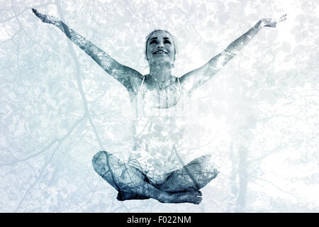 Composite image of toned young woman sitting with arms outstretched - Stock Photo