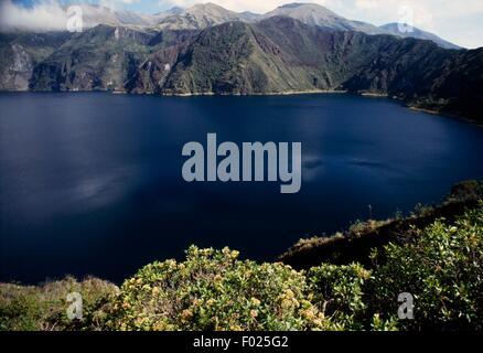 Lake Cuicocha, wide caldera and crater lake at the foot of Cotacachi Volcano, Andes, Ecuador. - Stock Photo
