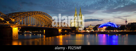 City-panorama of Cologne at dusk, Rhine, Hohenzollern Bridge, cathedral, the Musical Dome, Colonius TV tower, Cologne - Stock Photo