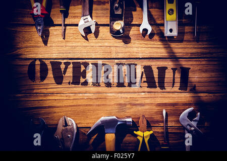 Overhaul against desk with tools - Stock Photo