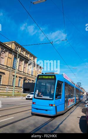 Tram, in front of Pinakothek der Moderne museum, Maxvorstadt, Munich, Bavaria, Germany - Stock Photo