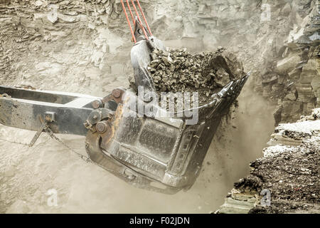 Bucket digger filled with lignite coal - Stock Photo