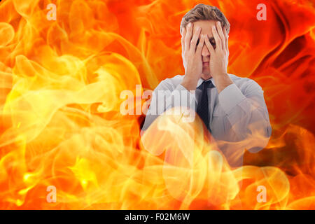 Composite image of businessman with a headache - Stock Photo