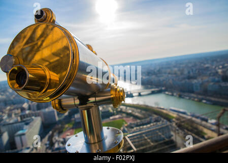 Telescope and view from the top of the Eiffel tower, Paris - Stock Photo