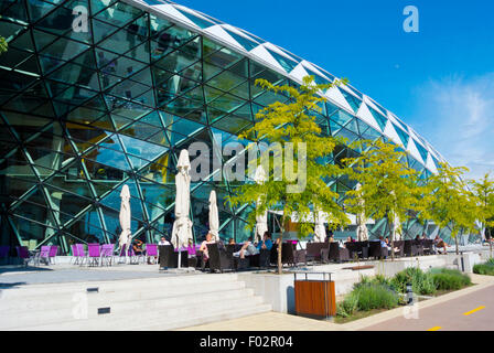 Cafe terraces, Balna, The Whale (2013), multipurpose building, housing shops and exhibition spaces, Budapest, Hungary - Stock Photo