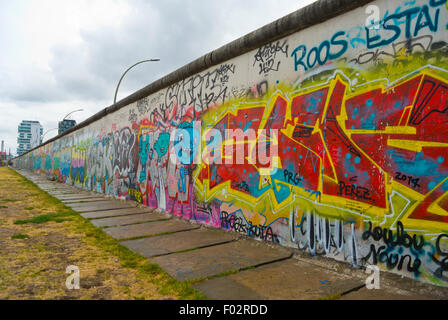 Longest remaining part of the wall, East Side Gallery, Friedrichshain, east Berlin, Germany - Stock Photo