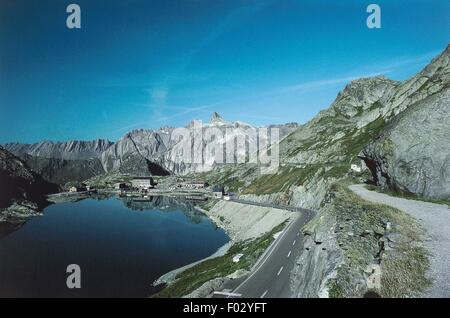 The Great St Bernard pass with Great St Bernard lake in the foreground, Aosta Valley, Italy. - Stock Photo
