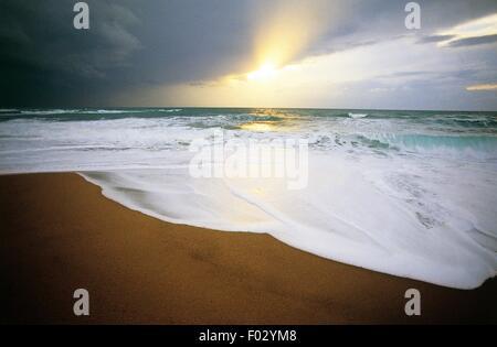 Clouds at sunset on the beach of Cirella on the Tyrrhenian coast, Calabria region, Italy. - Stock Photo