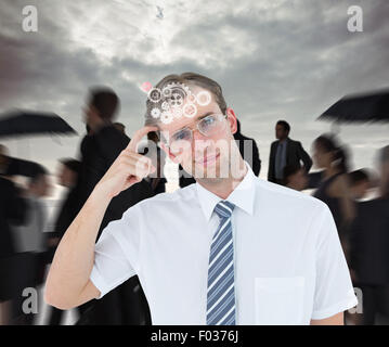 Composite image of geeky businessman thinking with finger on temple - Stock Photo