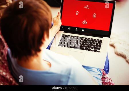 Composite image of pregnant woman using her laptop - Stock Photo
