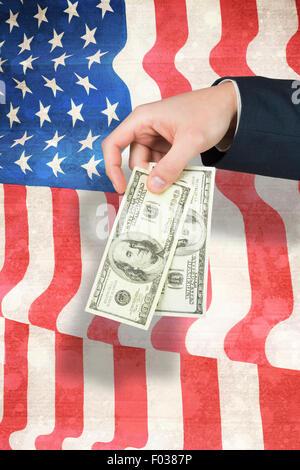 Composite image of hand holding hundred dollar bills - Stock Photo