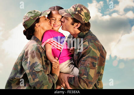 Composite image of soliders reunited with children - Stock Photo