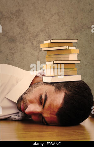 Composite image of tired businessman resting on his desk - Stock Photo