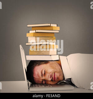 Composite image of tired businessman resting on laptop - Stock Photo