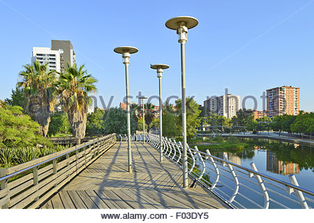 Parc Diagonal Mar wooden walkway with modern properties in background, Barcelona Catalonia Spain Europe - Stock Photo