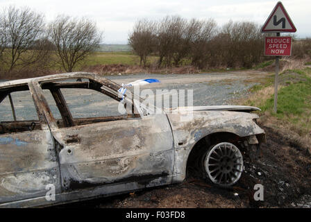 Stolen burnt out car - Stock Photo