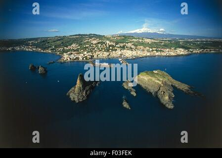 Aerial view of the Faraglioni dei Ciclopi, tall rocks off the coast of Aci Trezza, frazione of Aci Castello - Province - Stock Photo