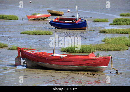 Beached sailing boats stranded in low tide. - Stock Photo