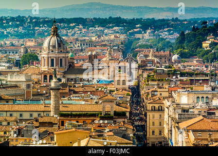 Rome skyline including the dome of the church San Carlo al Corso. Italy - Stock Photo