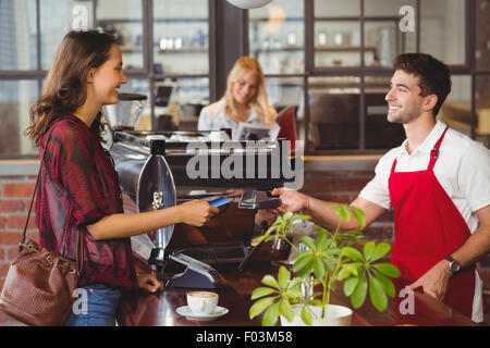 Customer handing a credit card to the waiter - Stock Photo