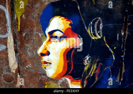 Graffiti vandalism or urban art - Stock Photo