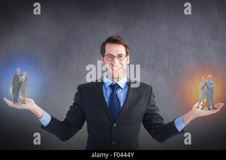 Composite image of business people using tablet computer - Stock Photo
