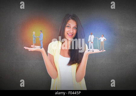 Composite image of  smiling business people shaking hands - Stock Photo