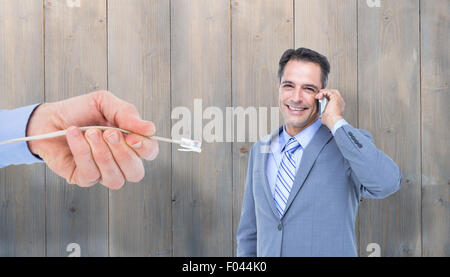 Composite image of  portrait of a successful businessman on phone against white - Stock Photo