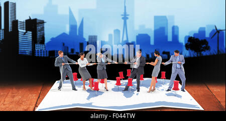 Composite image of business team pulling the rope - Stock Photo