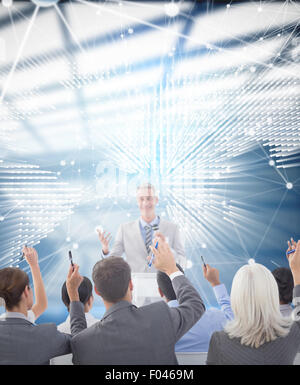 Composite image of business people raising their arms during meeting - Stock Photo
