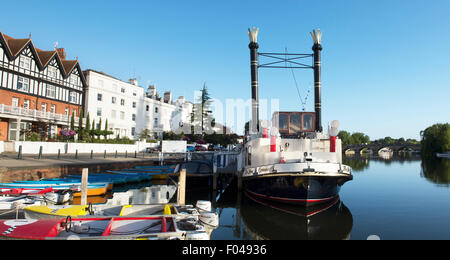 Paddle steamer 'New Orleans' and hire boats on the river in the early morning light at Henley on Thames, Oxfordshire, - Stock Photo