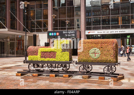 A floral artwork in the forecourt of Snow Hill Railway Station, Birmingham, England - Stock Photo