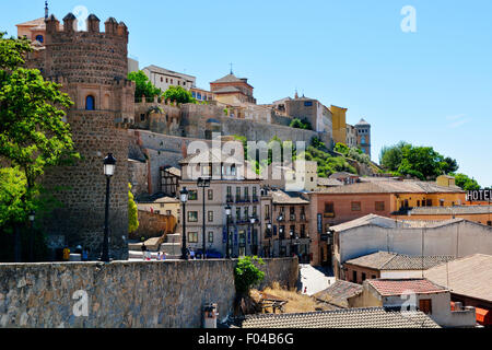 The steep slope that Toledo is built on, rooftops, roads and city boundary, Spain - Stock Photo