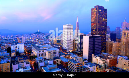 Aerial view of San Francisco cityscape at sunset with city lights - Stock Photo