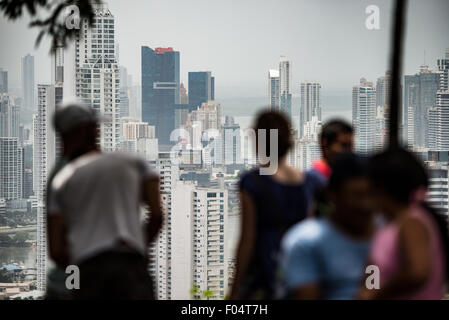 PANAMA CITY, Panama--Tourists look out over the highrises of the new area of Panama City from the top of Ancon Hill. - Stock Photo