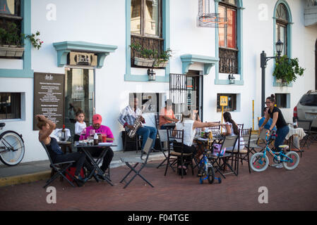 PANAMA CITY, Panama--Customers sit at outdoor tables outside a cafe in Casco Viejo, the historic old quarter of - Stock Photo