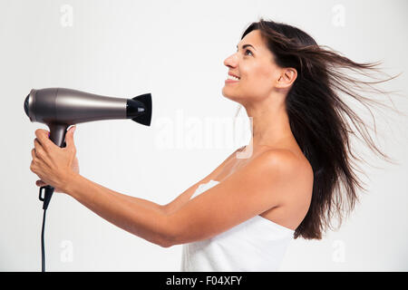 Happy beautiful woman in towel drying her hair isolated on a white background - Stock Photo