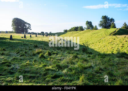 Avebury stone circle, North West Quarter, view earthwork, bank and ditch, with stones along one edge - Stock Photo