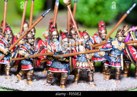 Close-up of metal painted model figures. Mass of Carthaginian foot soldiers advancing on table top battlefield - Stock Photo