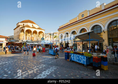 A stand with fruit in front of the metro station in Monastiraki square in Athens - Stock Photo