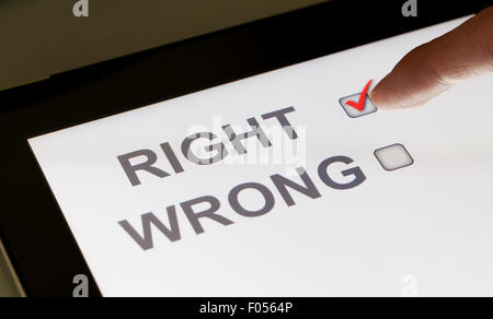 Right and wrong checkboxes on a tablet - Stock Photo