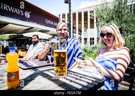 Couple drinking beer outside Barcelona's Stadium, Camp Nou, Barcelona, Spain. - Stock Photo