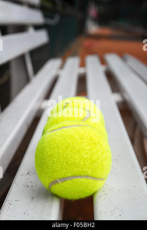 Tennis balls ready for play on the tennis court. - Stock Photo
