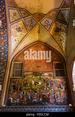 vaulting of main hall and painting of the battle of Shah Isma'il and the Uzbeks, Chehel Sutun Palace, Isfahan, Iran - Stock Photo