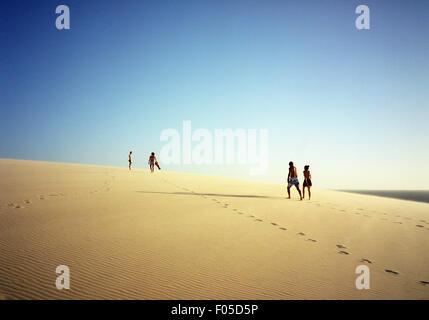 People climb up Sunset Dune for the sunset. Jericoacoara, Brazil - Stock Photo